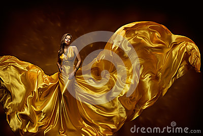Fashion Model Woman Dress, Lady In Fluttering Silk Beauty Gown, Fabric Waving On Wind, Beautiful Girl With Long Flying Cloth Stock Photo
