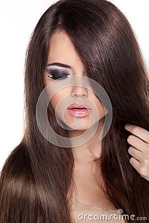 Fashion Model Woman with Long Healthy Brown Hair. Beauty Brunett