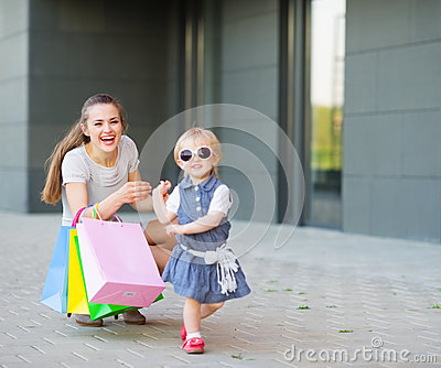 Fashion-monger baby on shopping with mom