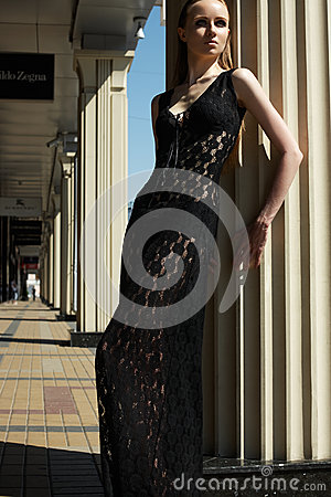 Fashion outdoors portrait of beautiful woman model in luxury black lacy dress