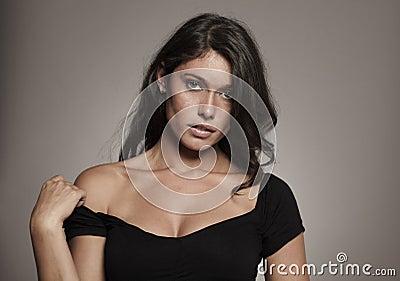Fashion photo brunette in studio