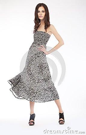 Fashion photo - lovely girl in grey dress - podium