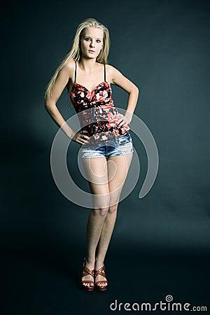 Fashion photo of young sensual woman in denim shor
