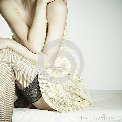 Fashion photo young sexual woman sitting on a sofa
