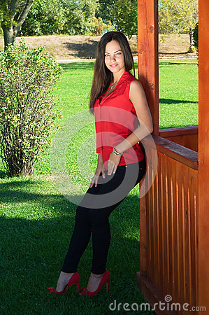 Fashion picture of a young beautiful woman leaned and posing aga
