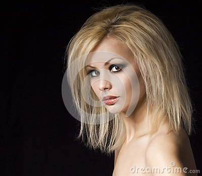 Fashion portrait. Beautiful blonde woman with professional makeup and hairstyle, over black. Vogue style model