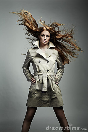 Fashion portrait beautiful woman in the raincoat