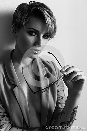 Free Fashion Portrait Of A Girl With Short Hair Wearing A Jacket With Glasses In Ha Stock Images - 88998074