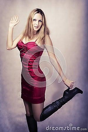 Fashion portrait of sexy happy dancing woman