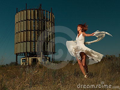 Fashion portrait woman twirling in white dress
