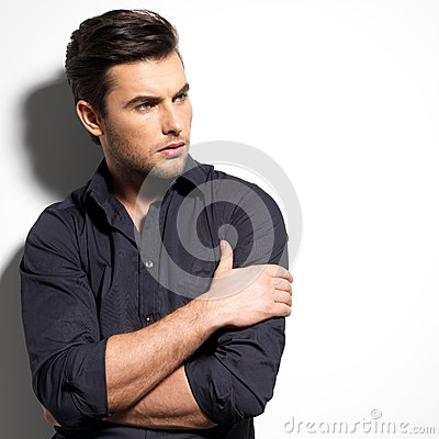 Fashion portrait of young man in black shirt
