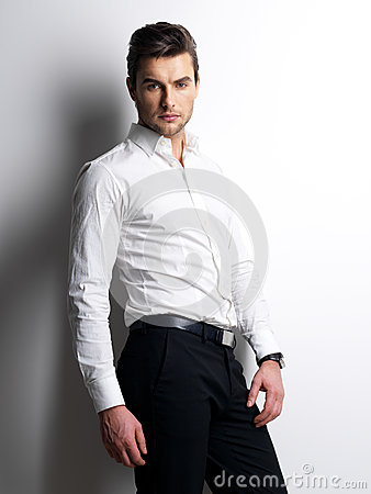 Fashion portrait of young man in white shirt