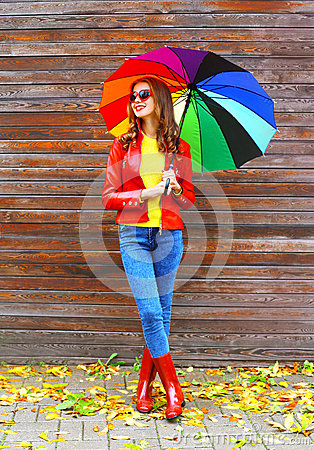 Free Fashion Pretty Woman With Colorful Umbrella Wearing A Red Leather Jacket And Rubber Boots In Autumn Over Wooden Background Royalty Free Stock Photos - 78645398