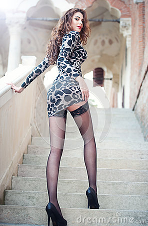 Fashion Pretty Young Woman With Long Legs Posing Outdoor On The ...