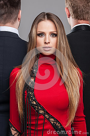 Fashion Shoot Of Blond Girl In Red Dress And Two Guys In