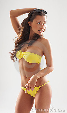 Fashion shoot of a woman in a yellow swimsuit