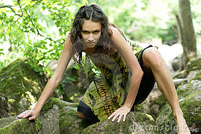 Fashion shoot of a young wild woman in a forest