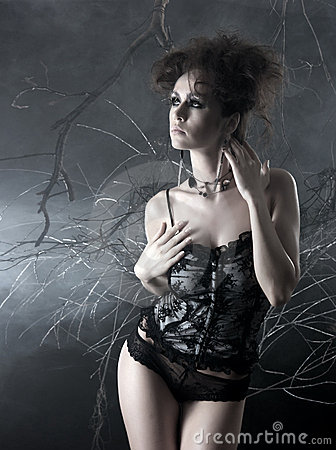Fashion shoot of a young woman in a bizarre dress