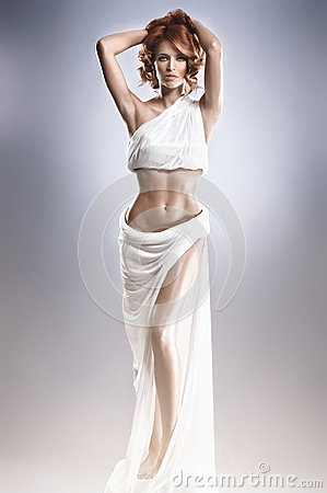 Fashion shoot of a young woman in a long dress