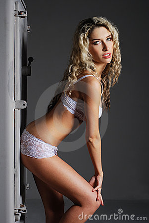 Fashion shoot of a young woman in white lingerie