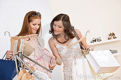 Fashion shopping -  Two happy woman choose clothes