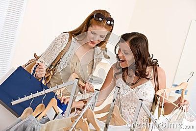 Fashion shopping - Two woman choose sale clothes
