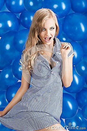 Fashion shot of summer girl in blue, she has both