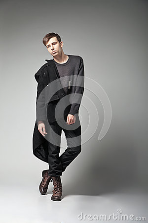 Fashion Shot of a young man in coat