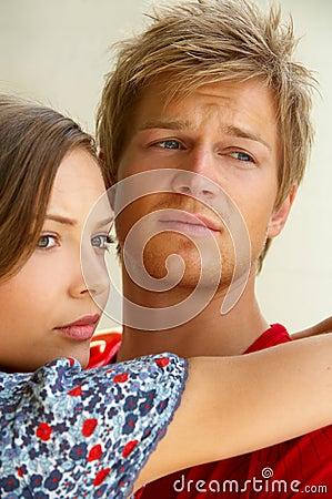 Fashion Shot of a young man comforting his girlfriend