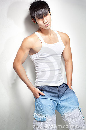 Fashion shot of young, muscular chinese man