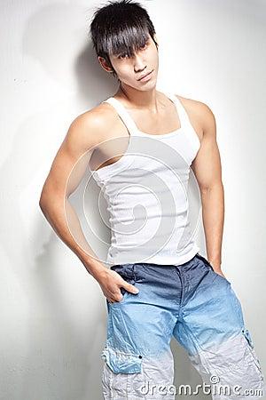 Fashion shot of young, muscular chinese man
