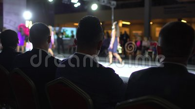 fashion show podium female model women girls stylish dresses designer walking runway audience viewers defile 143090543