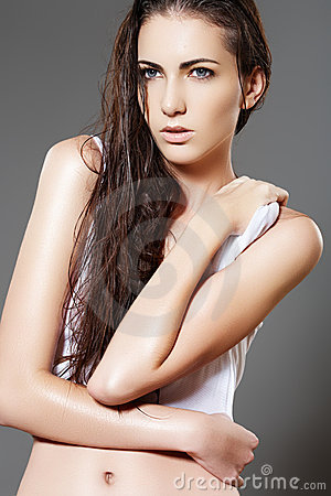 Fashion slim wet woman model with long shiny hair