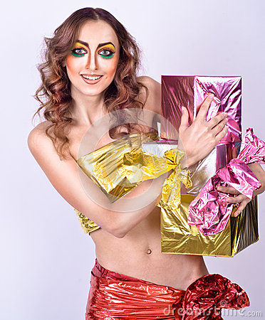 Fashion smiling woman model with presents