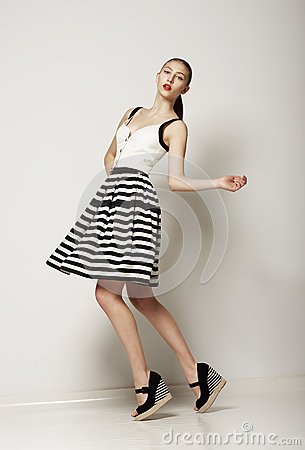 Fashion Style. Happy Young Shopper in Contrast Striped Grey Skirt. Movement