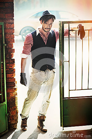 Fashion style man in the old wicket gate