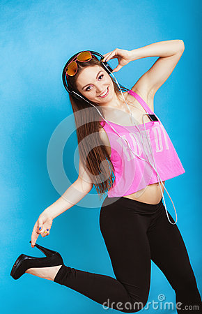 Fashion teen girl listen music mp3 relax happy and dancing Stock Photo