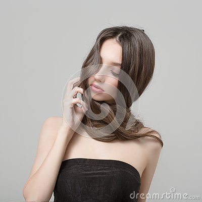 Fashion woman with beautiful long hair. Caring for a woman with a beautiful make-up Stock Photo