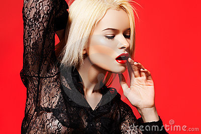 Fashion woman in dynamic model pose, lace shirt