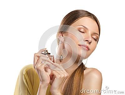 Fashion woman  enjoying  perfume