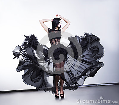 Fashion woman in fluttering transparent dress