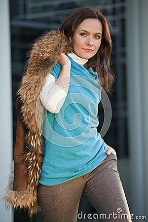 Fashion woman holds fox coat
