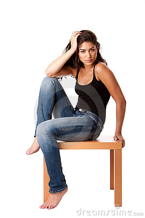 Fashion woman with jeans sitting