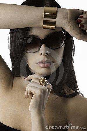 Fashion woman with jewellery red nails