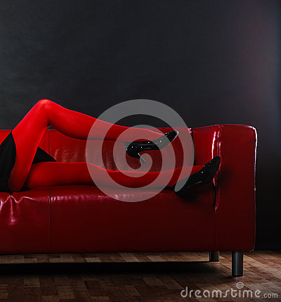 Free Fashion Woman Legs Red Pantyhose On Couch Stock Photography - 51858402