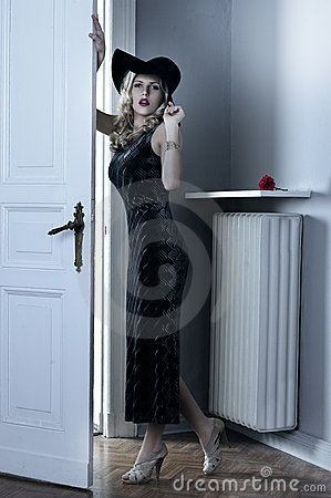 Fashion woman with long black dress and hat