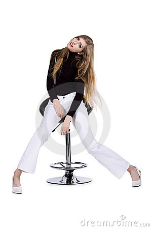 Fashion women sit on the chair on white