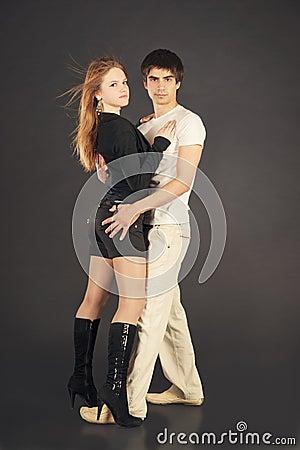 Fashion young couple, studio shot on black
