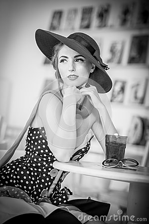 Free Fashionable Attractive Lady With Hat And Scarf Sitting In Restaurant, Indoor Shot. Young Woman Posing In Elegant Scenery Stock Images - 54479514