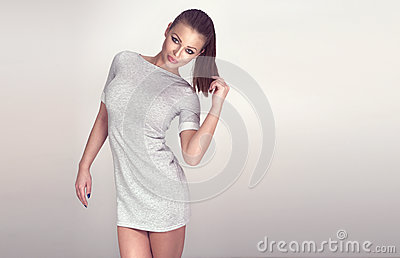 Fashionable brunette beauty posing.